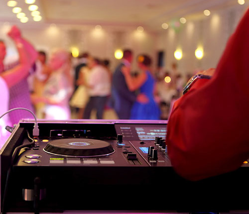Disc Jockey at Party